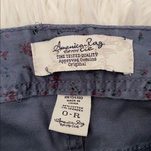 AMERICAN EAGLE WINE FLORAL SKINNY JEANS